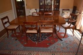 Gorgeous Duncan/Hepplewhite Double Pedestal Dining Table with 8 Beautiful Dining Room Chairs also in Background is a glimpse of the Lovely Matching Hepplewhite China Cabinet all elegantly displayed upon a  Romanian Serapi Rug