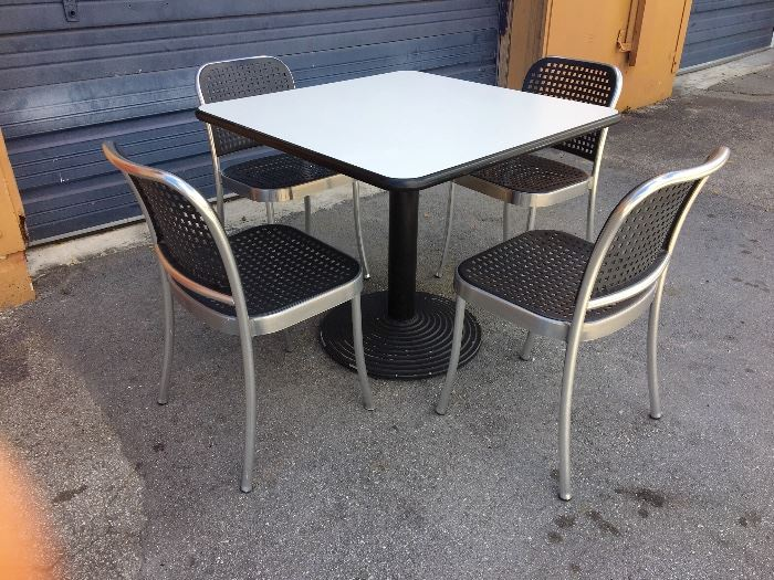 Several Modern White Tables 12 Herman Miller Side Chairs
