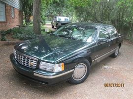 1997 CADILLAC DEVILLE D'ELEGANCE 102,900 MI. THIS CAR IS IN VERY GOOD CONDITION. IT IS A DARK GREEN EXTERIOR WITH CREAM LEATHER SEATS & INTERIOR