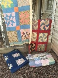 Few of the handmade quilts found on the second floor of the home.  Not pictured but will be for sell is a very old and EXTREMELY rare type of patchwork quilt, patches are made of denim, pieces of old feed sacks, shirts, overhauls etc. quilt made for necessity will try and get a picture of it soon.