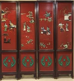 Chinese four panel cinnabar screen overlaid with green and white jade, agate, turquoise, lapis, malachite, and various colored stones