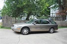 2003 Mercury Sable. 77,000 miles. 24 valve dual overhead camshafts. Has small oil leak-we have an estimate for repair from Gear Heads Garage and will subtract that amount from Blue Book value.