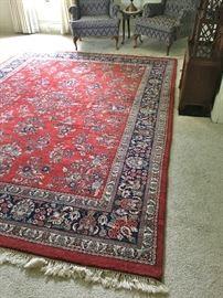 "This heavy wool rug measures 10'8"" x 8'2"""