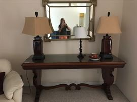 Long antique table came from Chicago hotel. Pair of Oriental style new lamps, Mirror.
