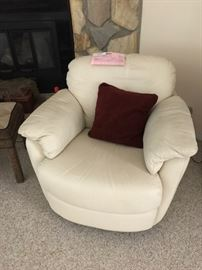 One of two swivel armchair
