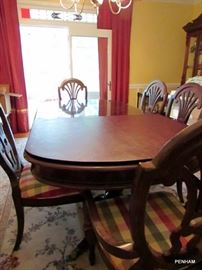 Table with 6 chairs and table pad.