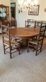 Table with leaves, 6 ladderback chairs, vintage china cabinet, storage shelving with Christmas dishware, & American Prescut glassware--extensive collection with duplicates!  Including punchbowl!