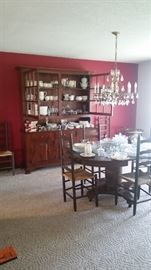 Upstairs formal dining room, custom-signed Amish china cabinet (made in Pennsylvania), round dining table (with 2 handmade extension leaves), 6 ladderback chairs, & multiple sets of china.