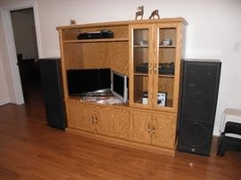 Oak tv/stereo cabinet, glass front.  Sherwood speakers, two flat screen personal size tvs.  Sherwood turntable