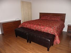 King size mattress and box spring.  Black leather type tufted storage foot stools.  Dresser, two night stands