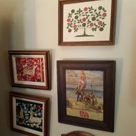 Framed needleworks (left) and print (lower right)