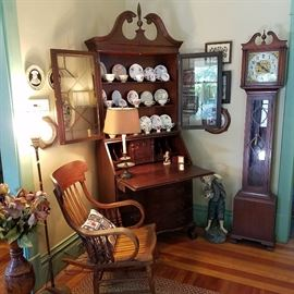 Mahogany colonial style secretary, Rocking chair, polychromed plaster figure of a boy (on the floor), and a Colonial Clock Company 'grandmother' clock.