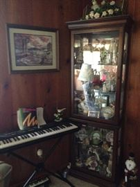 One of two curio cabinets filled with collectibles!
