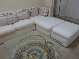 couch sectional beautiful white with accent primary colorful pillows Leon Rosen PACE coffee table with rose area rug