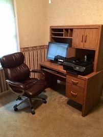 Executive chair and contemporary computer desk