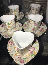 Super cute little heart shaped tea cups and matching saucers