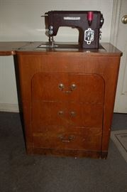 Kenmore Model 11797 sewing machine with cabinet in excellent condition.  Still operational.