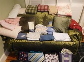 Linens including sheets, pillows, pillowcases, down comforter, futon cover, lunchboxes and more