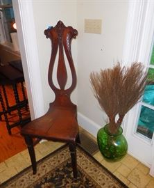 Antique violin back chair and decorative green vase