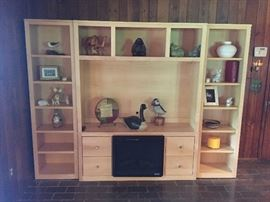 3 piece wall unit- center unit has fireplace in base, 2 side sections are separate pieces for transport