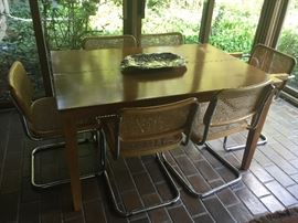 kitchen/dining table with 10 matching chairs