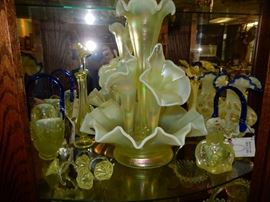 A very large variety of Vaseline, Custard, Satin and Fenton Glass.