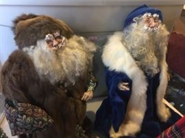 Porcelain Santa Clauses in fur and broacade and velvet coats