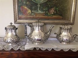 Tiffany & Co. by Grosjean & Woodard  3 piece Tea Service ( English Sterling) 925-1000 Teapot Pattern # 3055 0rder # 3 Creamer and Sugar Pattern # 2539 order # 3-1854-1870 Pear shape bodies, scalloped borders, floral and acanthus repousse hand chased decoration , handles with vines and leaf relief , creamer with mask on spout .Monogram (Russell)