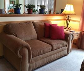 Neutral loveseat, Attic Heirlooms by Broyhill side table.