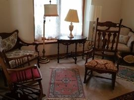 Rockers, settee, side tables, floor lamp, small Oriental rugs