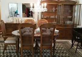 Dining room furniture includes table with 2 leaves, lighting china cabinet, buffet