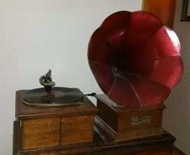 Another Victor Talking Machine and a Columbia Graphophone record player with awesome red horn