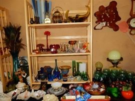two tables filled with unique small collectibles