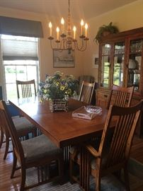 Mission Dining room set.  Table, China Cabinet, buffet and 6 chairs.  Extra chairs also available.