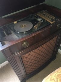 Antique phonograph and wire recorder with original paperwork and wire.