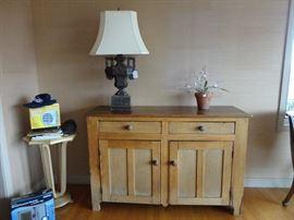 Primitive pine cabinet; handcarved wood urn lamp