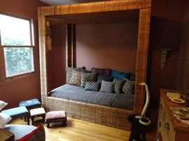 Twin canopy bed from Australia; pillows; footstools