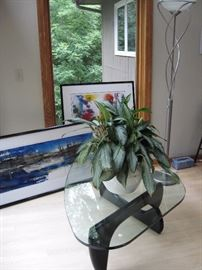 Glass coffee table and art work