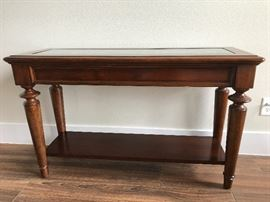 Bassett's console table best for formal or family room.