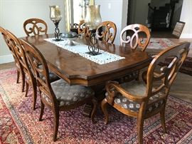 Thomasville's dining table with 8 chairs. Can seat up to 10 with an extra leaf(included)