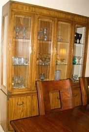 Large, 3 light Thomasville china cabinet with storage in base.