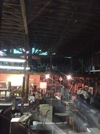 Warehouse full of vintage and antique furniture