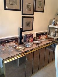 Beautiful mirrored side board (SOLD) topped with numerous serving pieces under a series of signed oriental serigraphs.