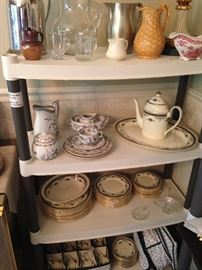 Pitchers and creamers on the top shelf! Vintage ironware on the second shelf left side! Minton Grasmere fine bone china on remaining shelf's!