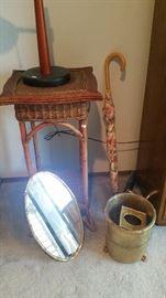 Gilded mirror, wicker table, brass