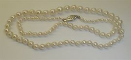 Graduated pearl necklace with 14k white gold clasp. 17.5""