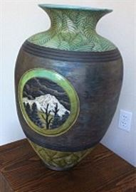 Large Christopher Mathie Raku urn with landscape vignet of a snowy Mt. Rainier and trees, with leaf patterning around top and bottom, measures 24.75 H x 15 W x 15 D inches, 1998, signed and titled on bottom.