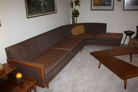 Great mid-century sofa.  Pillows are interchangable with stripes on one side and solid on the other.