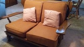 Colonial style loveseat.