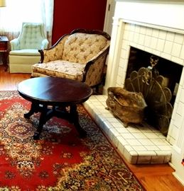 View of coffee table and damask print side chair.   Beautiful cast iron cachepot and brass fire screen.  Very nice brass items.